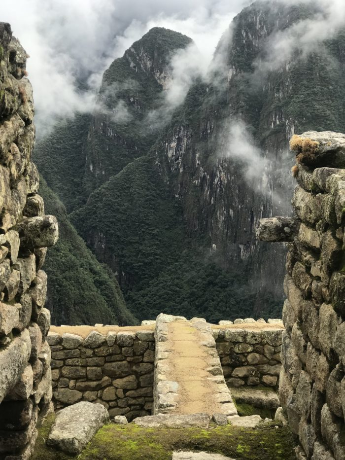 view between the ancient rocks of Macchu Picchu